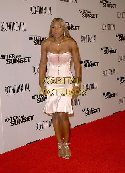 """SERENA WILLIAMS.The New Line Cinema's L.A. Premiere of """"After the Sunset"""" held at The Mann's Chinese Theatre in Hollywood, California .November 4, 2004.full length, silk, satin strapless dress, corset, bustier.www.capitalpictures.com.sales@capitalpictures.com.© Capital Pictures."""