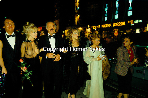 Jacques Medecin former Mayor of Nice South of France after a premier Cannes Film festival woman on his right arm with red rose is  Bobbie Bresee an American film actress and starlet. Cannes France 1980