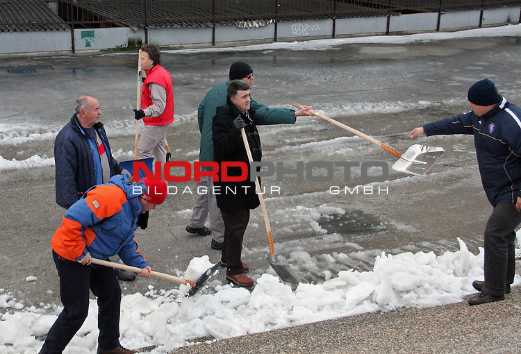 Volunteers clean the remains of snow in front of the Poljud Stadium in Split, February 8, 2012. The heavy snow storm that hit the city during the weekend has caused significant problems in traffic and has blocked the city for two days. Over 30 cm of snow that have fallen on the city is the biggest amount of snow in the history of Split. <br /> <br /> Foto &copy;  nph / PIXSELL / Ivana Ivanovic