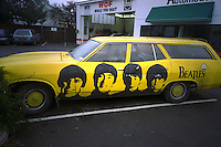 Ford Falcon station wagon with Beatles igsignia painted on side.