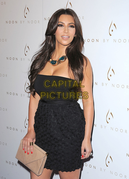 Kim Kardashian .The Noon by Noor launch event at At the Sunset Tower in West Hollywood, California, USA..July 20th, 2011         .half length black strapless dress skirt top circles necklace gold blue beige clutch bag.CAP/RKE/DVS.©DVS/RockinExposures/Capital Pictures.