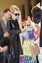 "Lady Gaga, wearing a black leather coat, sunglasses, high heels and her rainbow-colored hair, is greeted by Japanese fans upon her arrival at Narita Airport, Tokyo, on Tuesday, May 8, 2012. .Lady Gaga is in Japan on a ""Lady Gaga/The Born This Way Ball"" world tour and will play four nights in an arena venue just outside of Tokyo."