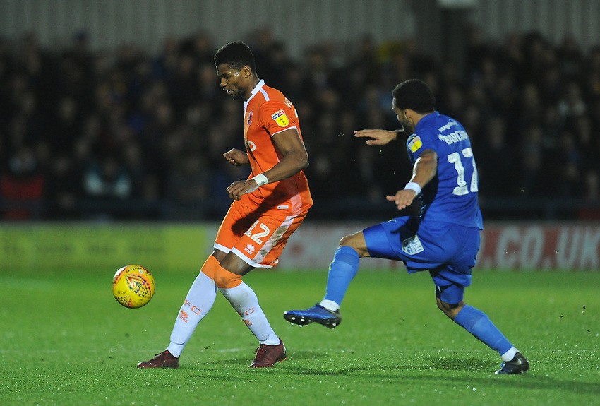 Blackpool's Michael Nottingham under pressure from AFC Wimbledon's Andy Barcham<br /> <br /> Photographer Kevin Barnes/CameraSport<br /> <br /> The EFL Sky Bet League One - AFC Wimbledon v Blackpool - Saturday 29th December 2018 - Kingsmeadow Stadium - London<br /> <br /> World Copyright © 2018 CameraSport. All rights reserved. 43 Linden Ave. Countesthorpe. Leicester. England. LE8 5PG - Tel: +44 (0) 116 277 4147 - admin@camerasport.com - www.camerasport.com