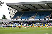 A one minute silence ahead of kick-off in memory of former Millwall Under-23 player Christian Mbulu during Millwall vs Swansea City, Sky Bet EFL Championship Football at The Den on 30th June 2020
