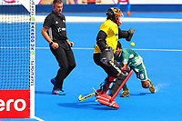 India's goalkeeper Vikas Dahiya blocks a shot with Pakistan's  Muhammad Irfan Jnr waiting for a rebound during the Hockey World League Semi-Final match between Pakistan and India at the Olympic Park, London, England on 18 June 2017. Photo by Steve McCarthy.
