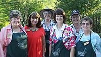 NWA Democrat-Gazette/CARIN SCHOPPMEYER Volunteers Anita Backus (from left), Gayle Howard, Peg Konert, Kathy Launder, Joanne Olszewski and Phyllis Wilkins welcome guests to Greening of the Garden.