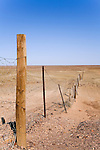 The Dog Fence - the longest continual fence in the world, stretching 5300km from Surfer's Paradise in Queensland to north of Ceduna in South Australia.  It was built to protect the sheep country in the south from the Dingo (native Australian dog).  Coober Pedy, South Australia, AUSTRALIA.