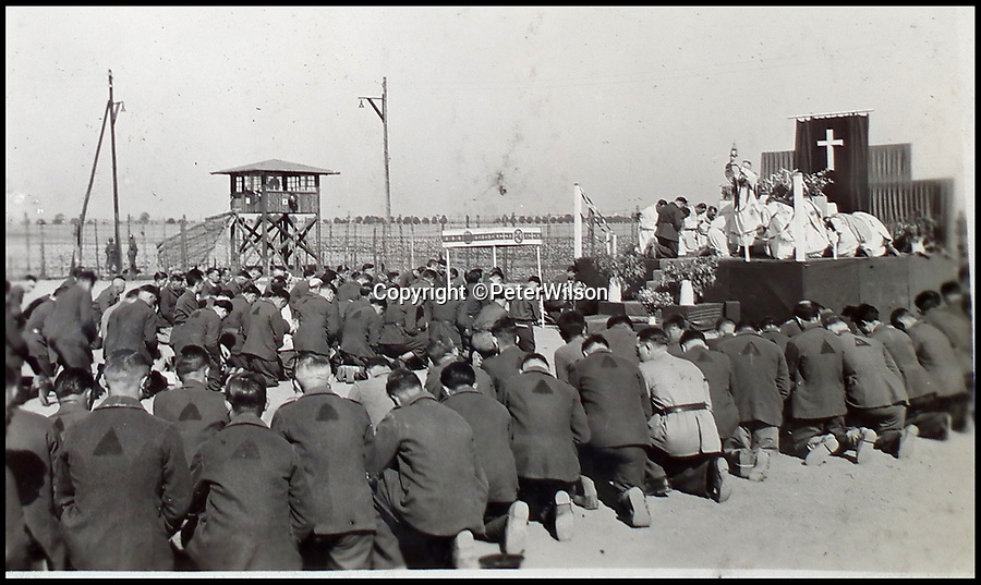 BNPS.co.uk (01202 558833)<br /> Pic: PeterWilson/BNPS<br /> <br /> French prisoners holding a church service.<br /> <br /> A fascinating photo album has to come to light to reveal what went on inside a German POW camp - including stage shows in drag.<br /> <br /> The Stalag Luft IV B album was compiled by British prisoner David Courtney, of 102 Squadron, whose Halifax was shot down near Berlin on January 20, 1944.<br /> <br /> One of the photos shows the funeral of a British soldier who was assassinated by the German guards, although they have taken part in the ceremony by lifting their guns above the coffin.<br /> <br /> Another shows a theatre performance put on by inmates where the performers were dressed as women to keep up morale.