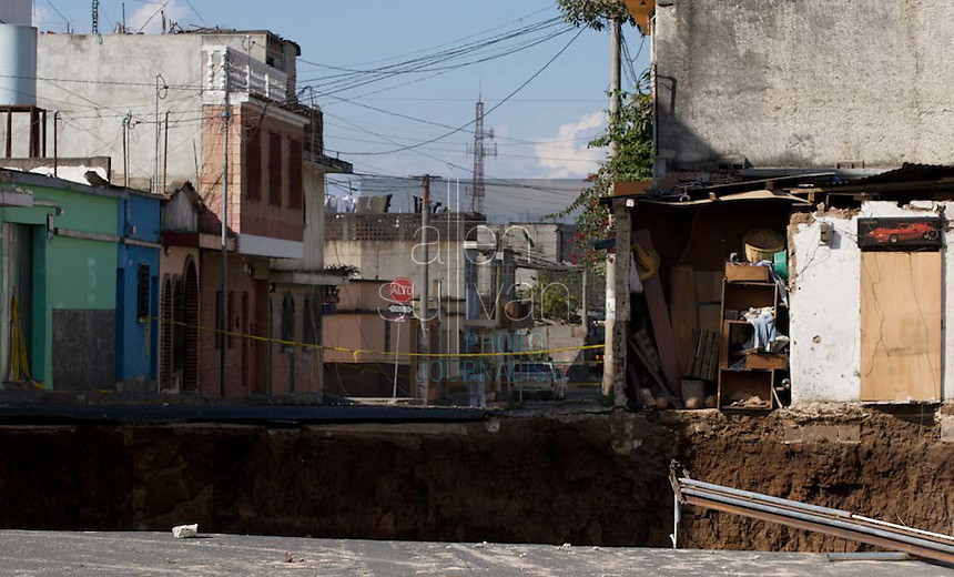 A 330-feet deep sinkhole that opened up on February 23 in the San Antonio neighborhood of Zone 6 in Guatemala City, Guatemala. The sinkhole claimed at least three victims, all from the same family that lived in the house seen at right. Authorities evacuated the area surrounding the hole and have it cordoned off. The hole emits foul odor and the sound of rushing water.