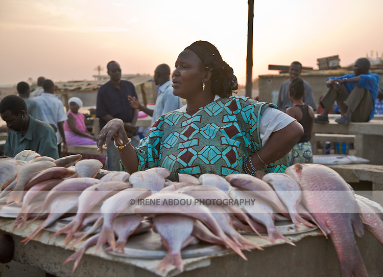 A woman sells fish at this beachside fish market in Dakar, Senegal.