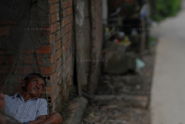 An old man rests during a hot day in Can Tho, Vietnam.