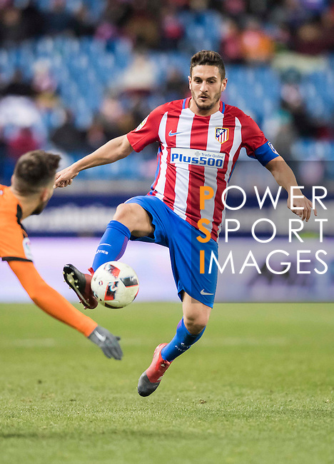 """Jorge Resurreccion Merodio """"Koke"""" (r) of Atletico de Madrid battles for the ball with Antonio Manuel Luna Rodriguez of SD Eibar during their Copa del Rey 2016-17 Quarter-final match between Atletico de Madrid and SD Eibar at the Vicente Calderón Stadium on 19 January 2017 in Madrid, Spain. Photo by Diego Gonzalez Souto / Power Sport Images"""