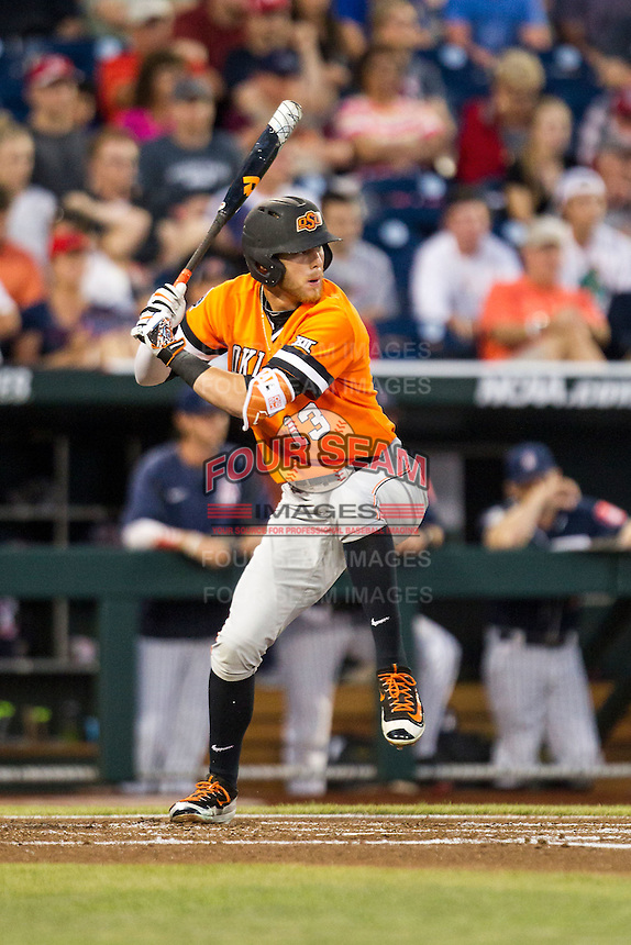 Oklahoma State Cowboys outfielder John Littell (13) at bat against the Arizona Wildcats during Game 6 of the NCAA College World Series on June 20, 2016 at TD Ameritrade Park in Omaha, Nebraska. Oklahoma State defeated Arizona 1-0. (Andrew Woolley/Four Seam Images)