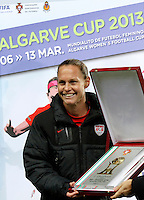 USA's Christie Rampone and Fernando Gomes, president of portuguese federation holds  the trophy after their Algarve Women's Cup soccer match final against Germany at Algarve stadium in Faro, March 13, 2013.  .Paulo Cordeiro/ISI
