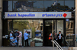Israelis use the services of a Bank Hapoalim branch in Zion Square, central Jerusalem.<br />