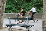 Couple with their dog riding bikes near the Louvre Museum, Paris, France. .  John offers private photo tours in Denver, Boulder and throughout Colorado, USA.  Year-round. .  John offers private photo tours in Denver, Boulder and throughout Colorado. Year-round.