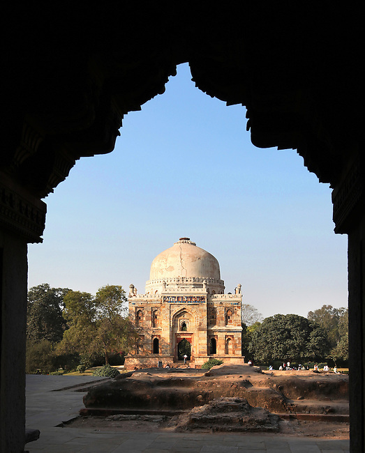 """The Lodi Gardens in New Delhi , India are possibly the most beautiful in the city; a magnet for families, young lovers, joggers and a variety of snake charmers, chai wallahs (tea sellers) and ordinary Delhiwallahs (Delhi local people) who come to lounge in the sun and explore the mughal tombs in the grounds. The  gardens are named after the Mughal Emperor Sikander Lodi whose tomb is located in the grounds. Pictured here is the Sheesh Gumbad (""""Glass dome"""") for the glazed tiles used in its construction, which contains the remains of an unknown family, this was also built during the reign of Sikander Lodi."""