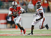 Ohio State Buckeyes quarterback J.T. Barrett (16) runs the ball with Virginia Tech Hokies defensive end Dadi Nicolas (90) on his tail during the college football game between the Ohio State Buckeyes and the Virginia Tech Hokies at Ohio Stadium in Columbus, Saturday afternoon, September 6, 2014. The Virginia Tech Hokies defeated the Ohio State Buckeyes 35 - 21. (The Columbus Dispatch / Eamon Queeney)