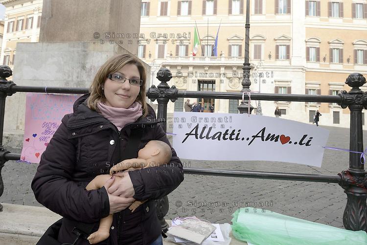 Roma, 18 Febbraio 2013.Piazza Montecitorio.Flash Mob avanti al Parlamento di mamme , donne e ostetriche per favorire la pratica di allattamento al seno anche in pubblico. Una giovane ostetrica con un bambolotto