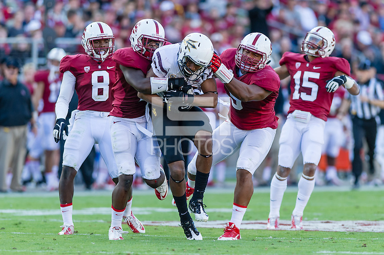 STANFORD, CA - SEPTEMBER 22, 2013: The defense makes a tackle during Stanford's game against Arizona State. The Cardinal defeated the Sun Devils 42-28.