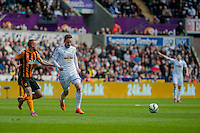 SWANSEA, WALES - APRIL 04: Gylfi Sigurosson of Swansea City in action during the Premier League match between Swansea City and Hull City at Liberty Stadium on April 04, 2015 in Swansea, Wales.  (photo by Athena Pictures)