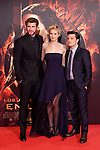 "Australian actor Liam Hemsworth, left, and the US actors Jennifer Lawrence and Josh Hutcherson, right, pose for photographers as they arrive to the premiere of their movie ""The Hunger Games: Catching Fire"" at Callao Cinema in Madrid, Spain.. November 13, 2013. (ALTERPHOTOS/Victor Blanco)"