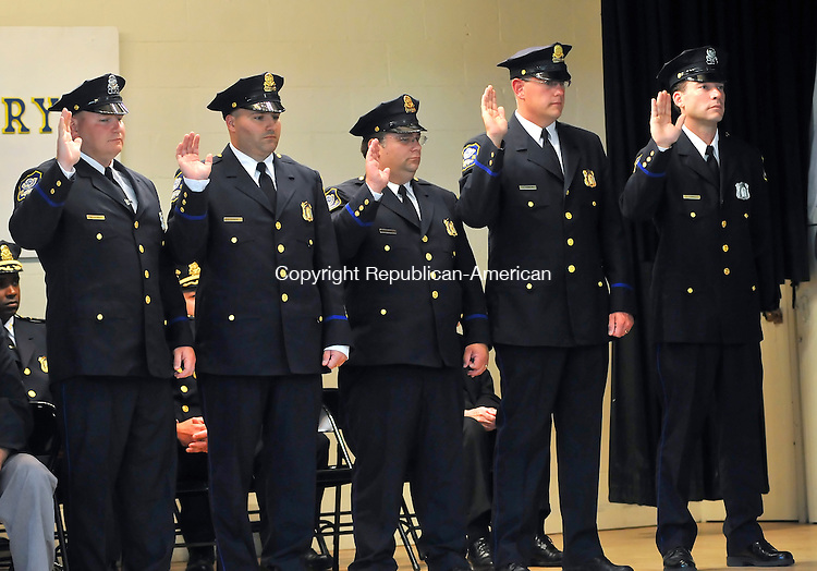 WATERBURY, CT-14 JULY 2009-071409JS11-Waterbury police officers, from left, Det. Michael Stokes; Det. Vincent Signore; Det. Rimothy Kluntz; Det. Gerald Hanson and Officer John Tomboly swear-in as they are promoted to the rank of sergeant during a ceremony Tuesday at the Police Activity League center in Waterbury. <br /> Jim Shannon Republican-American