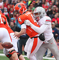 Ohio State Buckeyes linebacker Ryan Shazier (2) causes Illinois Fighting Illini quarterback Reilly O'Toole (4) to fumble in the third quarter at Memorial Stadium in Champaign, Illinois on November 16, 2013. The play resulted in a safety.  (Chris Russell/Dispatch Photo)