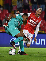 BOGOTA-COLOMBIA, 08-03-2020: Diego Valdes de Independiente Santa Fe y Jose Cuadrado de Atletico Nacional disputan el balon durante partido entre Independiente Santa Fe y Atletico Nacional de la fecha 8 por la Liga BetPlay DIMAYOR 2020 jugado en el estadio Nemesio Camacho El Campín de la ciudad de Bogota. / Diego Valdes of Independiente Santa Fe and Jose Cuadrado of Atletico Nacional vie for the ball during a match of the 8th date between Independiente Santa Fe and Atletico Nacional, for the BetPlay DIMAYOR I Leguaje 2020 at the Nemesio Camacho El Campin Stadium in Bogota city. / Photo: VizzorImage / Luis Ramirez / Staff.
