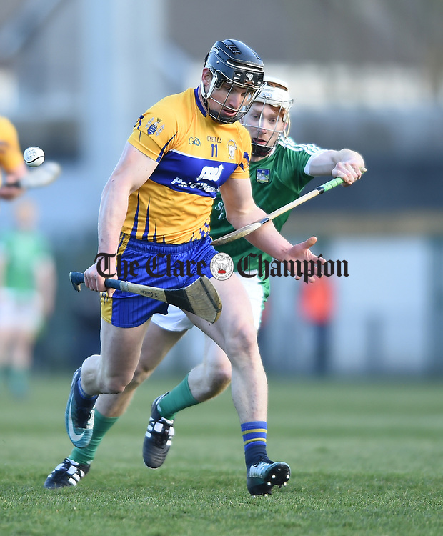 John Conlon of  Clare  in action against Cian Lynch of  Limerick during their NHL quarter final at the Gaelic Grounds. Photograph by John Kelly.