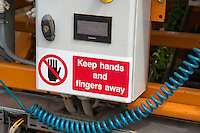Warning sign on machine