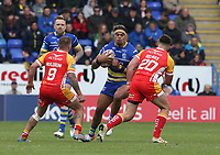 Warrington Wolves' Sitaleki Akauola is tackled by Catalans Dragons' Michael McIlorum (left) and Lambert Belmas <br /> <br /> Photographer Stephen White/CameraSport<br /> <br /> Betfred Super League Round 17 - Warrington Wolves v Catalans Dragons - Saturday 8th June 2019 - Halliwell Jones Stadium - Warrington<br /> <br /> World Copyright © 2019 CameraSport. All rights reserved. 43 Linden Ave. Countesthorpe. Leicester. England. LE8 5PG - Tel: +44 (0) 116 277 4147 - admin@camerasport.com - www.camerasport.com
