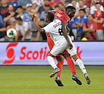 Marcos Sanchez (8) of Panama and Jozy Altidore (17) of the United States vie for the ball during their Gold Cup match on June 26, 2019 at Children's Mercy Park in Kansas City, KS.<br /> Tim VIZER/AFP