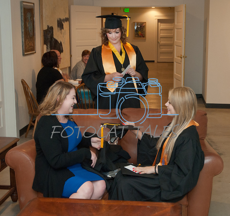 WNC students Stephanie Bishop, left, Brittany Esposito and Kim Moore chat prior to commencement at the Western Nevada College in Fallon, Nev., on Tuesday, May 20, 2014. <br /> Photo by Kim Lamb