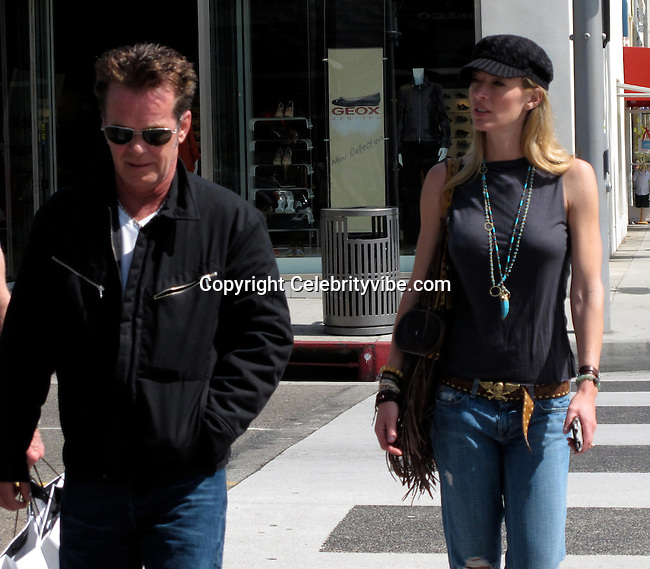**EXCLUSIVE**.John Mellencamp with wife Elaine Irwin Mellencamp shopping in Beverly Hills, note how he is still smoking..Beverly Hills, CA, USA..Saturday, March 20, 2010..Photo By CelebrityVibe.com.To license this image please call (212) 410 5354; or Email: CelebrityVibe@gmail.com ; .website: www.CelebrityVibe.com.