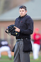 Home plate umpire Drew Maher between innings of the NCAA baseball game between the Wake Forest Demon Deacons and the Davidson Wildcats at Wilson Field on March 19, 2014 in Davidson, North Carolina.  The Wildcats defeated the Demon Deacons 7-6.  (Brian Westerholt/Four Seam Images)