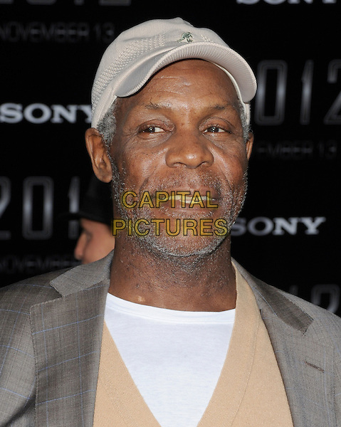"""DANNY GLOVER .The Sony Picture Studios' Premiere of """"2012"""" held at Regal Cinemas Live in Los Angeles, California, USA. .November 3rd, 2009.headshot portrait stubble facial hair grey gray beige white baseball cap hat.CAP/RKE/DVS.©DVS/RockinExposures/Capital Pictures."""