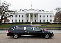 The hearse carrying the flag-draped casket of former President George H.W. Bush passes by the White House from the Capitol, heading to a State Funeral at the National Cathedral, Wednesday, Dec. 5, 2018, in Washington. <br /> CAP/MPI/RS<br /> &copy;RS/MPI/Capital Pictures