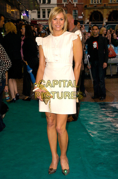 """JENNI FALCONER.Arrivals - """"Harry Potter and the Order of the Phoenix"""" European premiere, Odeon cinema, Leicester Square London, England, 3rd July 2007..full length white dress cream buttons bib front frilly sleeves clutch bag gold.CAP/CAN.©Can Nguyen/Capital Pictures"""