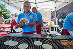 A member of Centro Market works at the Centro Market booth during the 20th Taste of Downtown, which is put on by the Advocates to End Domestic Violence, in Carson City, Nev., on Saturday June 15, 2013.<br /> (Photo by Kevin Clifford/Nevada Photo Source)