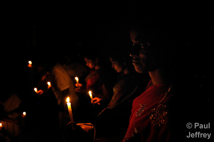 People infected by and affected by HIV and AIDS gather for a candlelight vigil in Guntur, Andhra Pradesh, India, to raise public awareness of the virus and the need to end stigma and discrimination against those living with it.