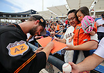 San Francisco Giants' Chase Johnson signs autographs before a spring training game against the Milwaukee Brewers in Phoenix, AZ, on Thursday, March 23, 2017.<br /> Photo by Cathleen Allison/Nevada Photo Source
