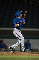 AZL Rangers infielder Frainyer Chavez (60) follows through on his swing during an Arizona League game against the AZL Cubs 2 at Sloan Park on July 7, 2018 in Mesa, Arizona. AZL Rangers defeated AZL Cubs 2 11-2. (Zachary Lucy/Four Seam Images)