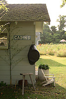 The contemporary clapboard shed is one of several 'outdoor rooms' in the garden