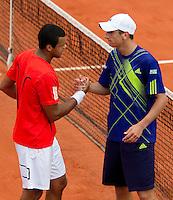 28-05-10, Tennis, France, Paris, Roland Garros, Thiemo de Bakker  schud de hand van Jo-Wilfriet Tsonga