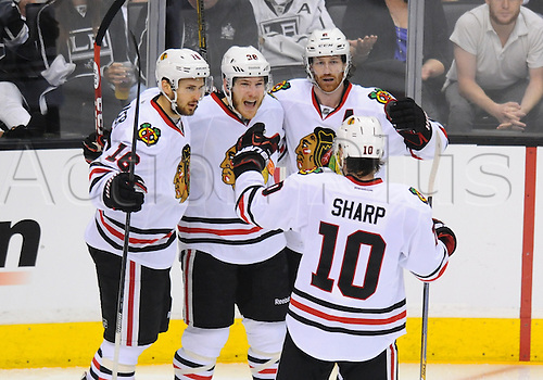 30.05.2014. Los Angeles, Ca, USA.  Chicago Blackhawks Center Marcus Kruger (16) [7642], Chicago Blackhawks Right Wing Ben Smith (28) [5620], Chicago Blackhawks Defenseman Duncan Keith (2) [2958] and Chicago Blackhawks Left Wing Patrick Sharp (10) [2463] celebrate scoring their second goal of the game during game 6 of the Western Conference Final between the Chicago Blackhawks and the Los Angeles Kings at the Staples Center in Los Angeles, CA.