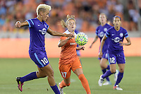 Houston, TX - Friday May 20, 2016: Orlando Pride midfielder Lianne Sanderson (10) and Houston Dash midfielder Andressa Machry (17). The Orlando Pride defeated the Houston Dash 1-0 during a regular season National Women's Soccer League (NWSL) match at BBVA Compass Stadium.