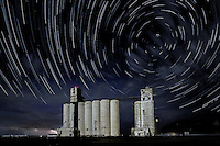 Grain elevator in the Oklahoma Panhandle taken at night with long exposure to capture the startrails.