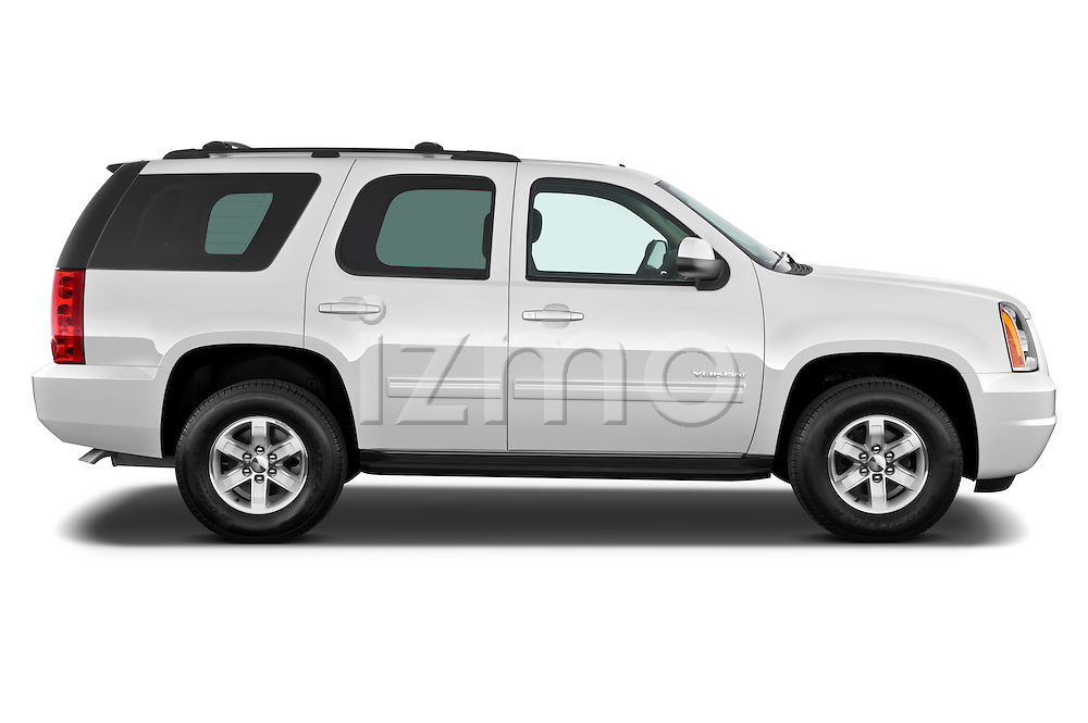 Passenger side profile view of a 2012 GMC Yukon SLE .
