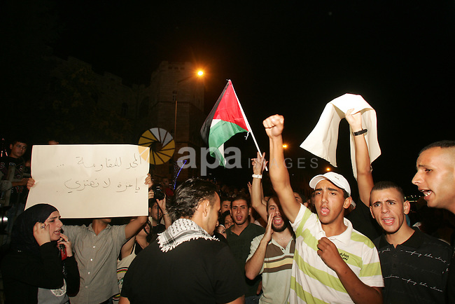 Protesters from several anti-war and pro-Palestinian groups gather at Damascus Gate of the Old City of Jerusalem on Aug. 21, 2011, to protest the disproportionate use of force by the Israeli armed forces during air-strikes on Gaza. Photo by Mahfouz Abu Turk